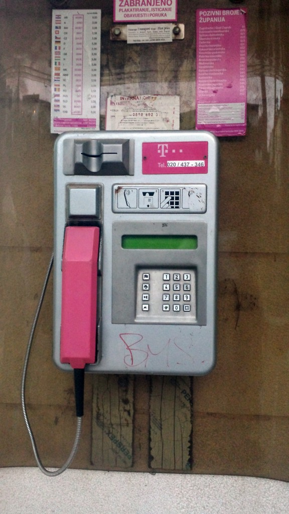 Public Pay Phone in Dubrovnik, Croatia with what appears to be the T Mobile Logo.