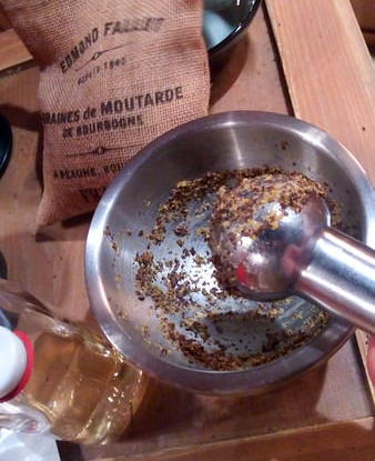 Mixing gourmet mustard seeds, vinegar, and salt on the Fallot tour