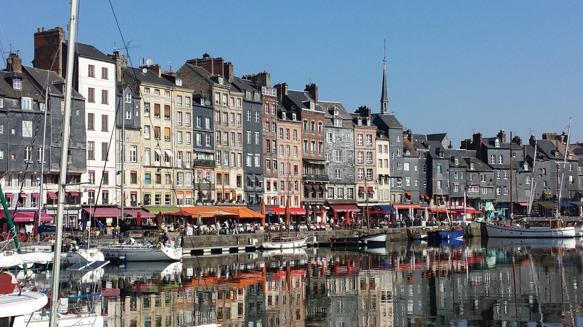 Reflection of Normandy base for exploration, Honfleur's architecture in the harbor water.