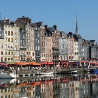 Reflection of Normandy base for exploration Honfleur's architecture in the harbor water.